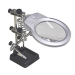 Helping hands tool with 90 mm magnifier lens (2 x magnification), LED lights & weighted cast iron base for stability and 2 articulated arms with crocodile clips for gripping.